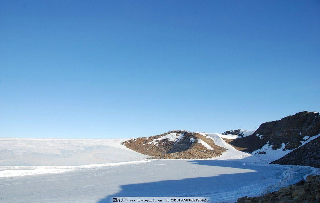 南极雪山 南极雪景 雪地 蓝天 雪景 山坡 阳光 自然风景 自然景观